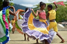 Afro-Colombian dances with colorful traditional clothing. Bahia Solano, Colombia. Photo © Kike Calvo