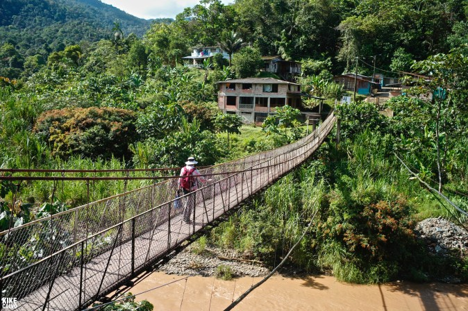 Crossing a hanging bridge with Colombia Photo Expeditions heading to Las Brujitas